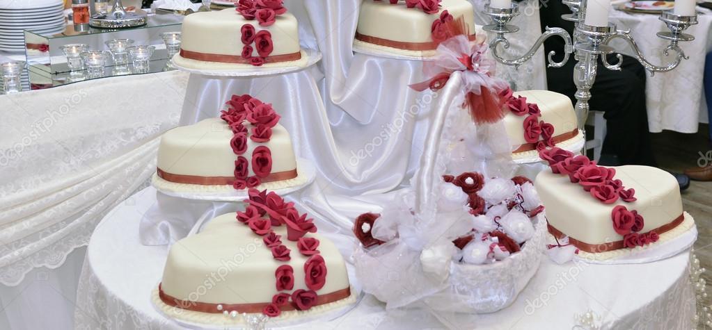 White Wedding Cake With Red Ribbons Stock Photo C Nehruresen 124690346