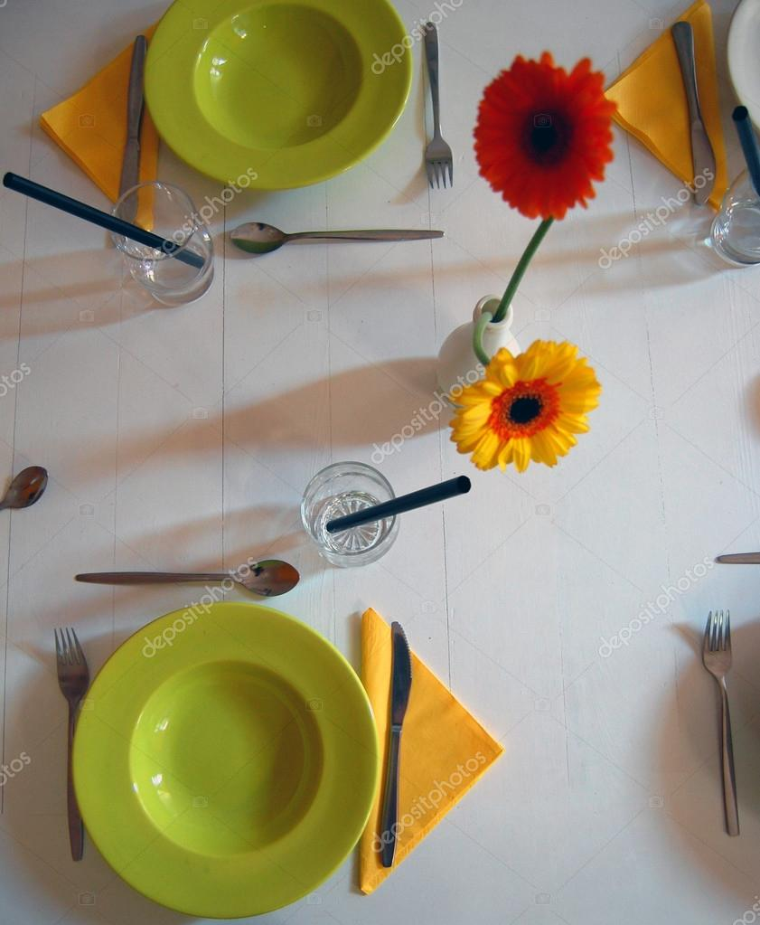 Empty plates on rustic white table