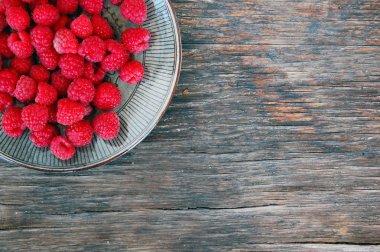 Raspberries on rustic wooden table