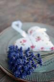 Lavender flower and lavender bag on table