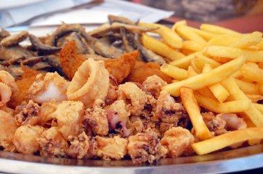 deep fried seafood with potatoes