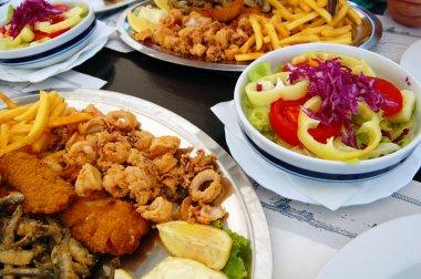 deep fried seafood with fresh salad