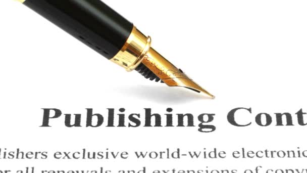 Fountain pen on publishing contract dolly shot