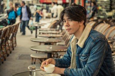 Man at Outdoor Paris Cafe