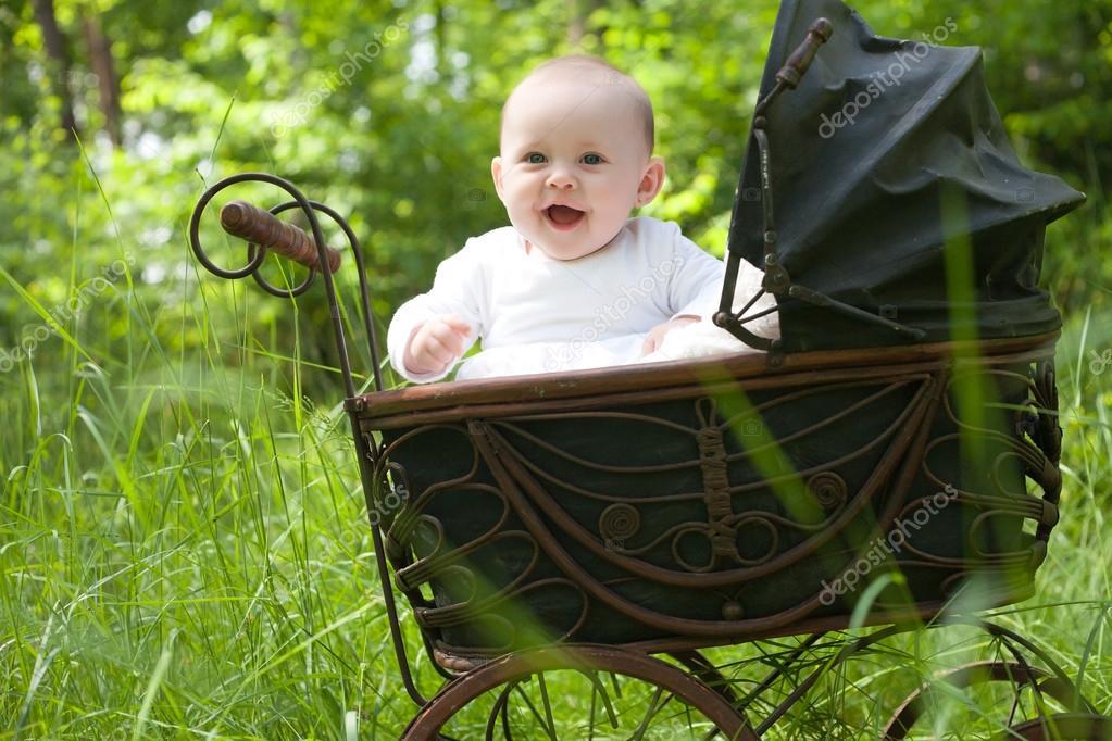 Happy baby in vintage pram