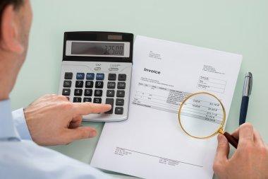 Businessperson Examining Invoice