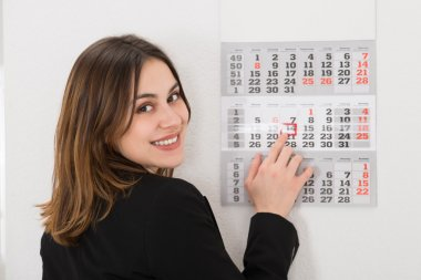 Businesswoman with Calendar Date