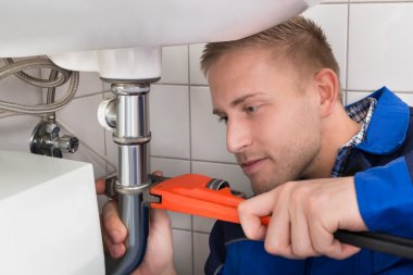Male Plumber Fixing Sink
