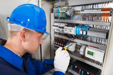 Male Electrician Examining Fusebox