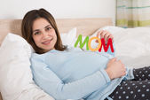Pregnant Woman With Text Mom