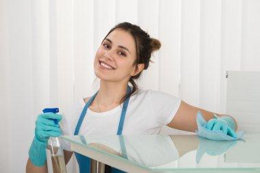 Female Janitor Using Spray