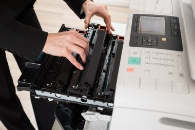 Businesswoman Hands Fixing Copy Machine