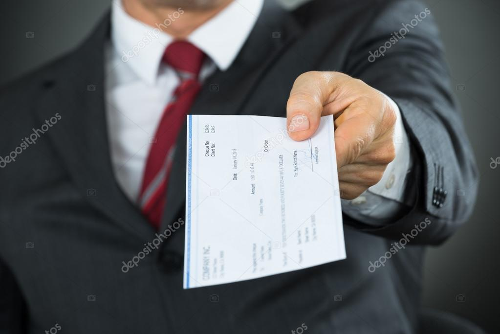 Businessman Hand Giving Cheque