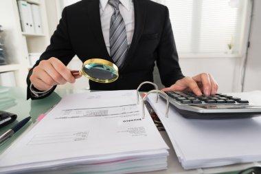 Young Businessman Analyzing Bills