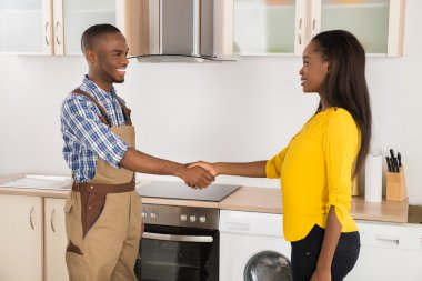 Serviceman And Woman Handshaking