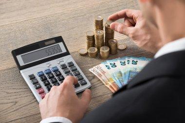 Businessman Calculating Profit