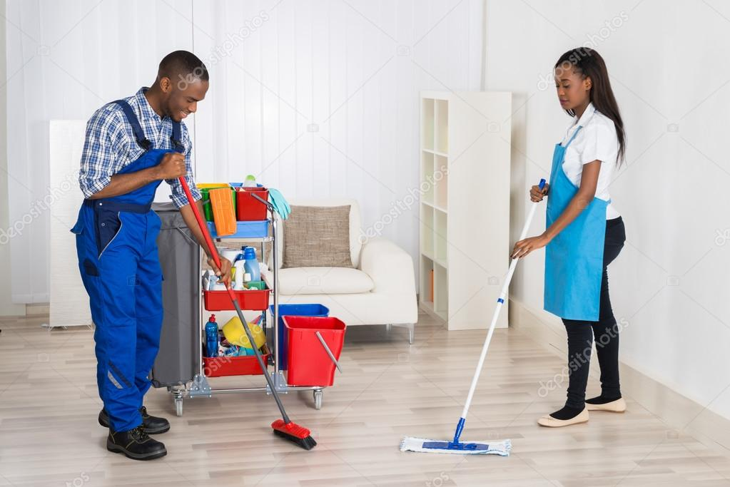 Janitors Cleaning Apartment — Stock Photo © AndreyPopov #108385986