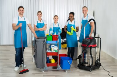 Cleaners With Cleaning Equipments In Office