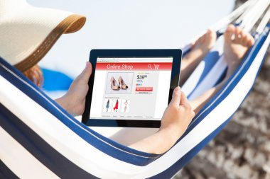 Woman Shopping Online While On Hammock