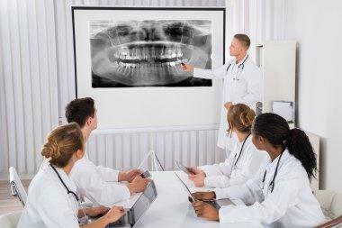 Doctor Explaining Teeth X-ray