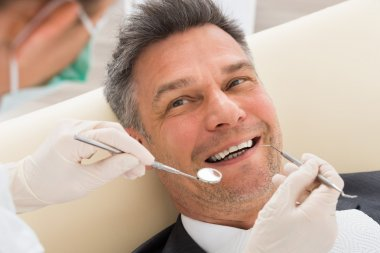 Man Having Dental Check-up In Clinic