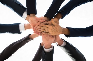 Businesspeople Hands Stacking