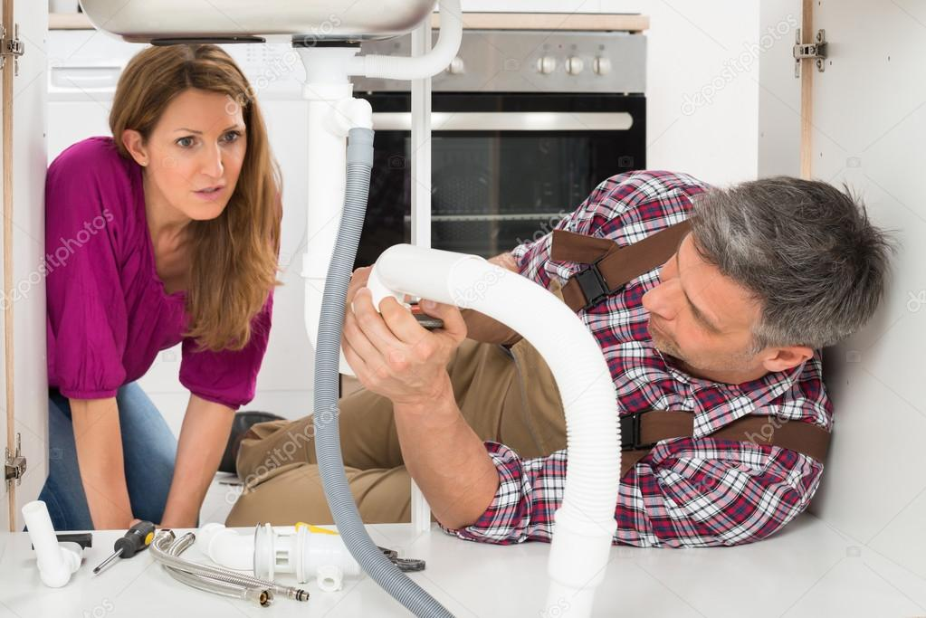 Mature Plumber Fixing Sink Pipe — Stock Photo © AndreyPopov #113659472