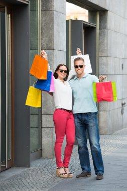 Couple Holding Shopping Bag
