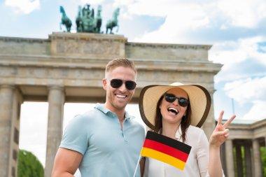 Happy Couple Holding German Flag