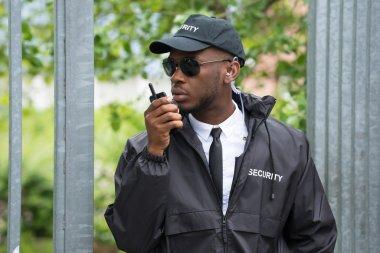 Security Guard Using Walkie-Talkie