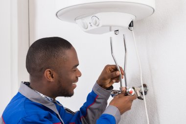 Plumber Repairing Electric Boiler