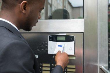 Businessman Using Keycard To Open Door