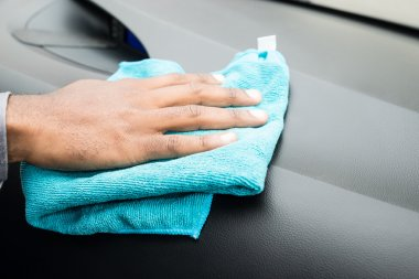 Person Hands Cleaning Car Interior