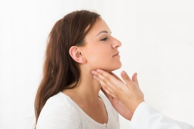 Doctor Hand Touching The Throat Of Patient