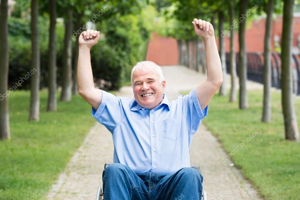 Happy Senior Man On Wheelchair