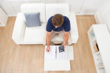 Man Calculating Home Finances