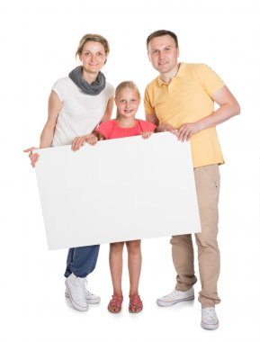 Happy Young Family Holding Banner