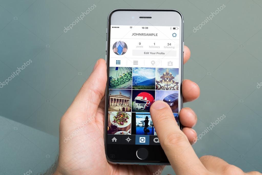 Hand Using Instagram On Apple iPhone6