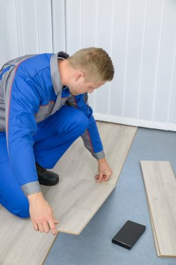 Worker Assembling New Floor