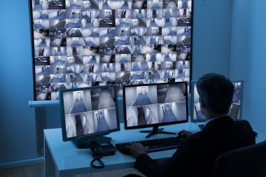 Man Monitoring Cctv Footage