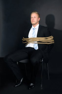 Businessman Tied To Chair