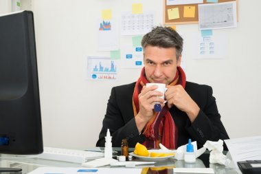Businessman With Muffler Drinking Tea