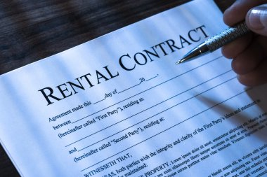 Person Filling Rental Agreement