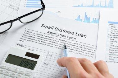 Hand On Loan Application