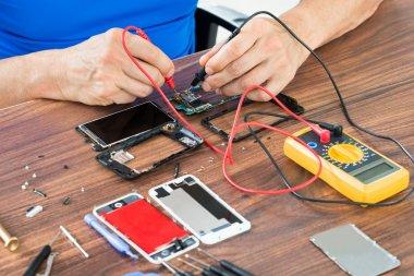 Human Hands  Repairing Cellphone