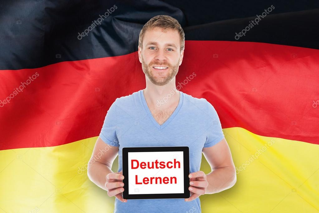 Man Holding Tablet With Learn German