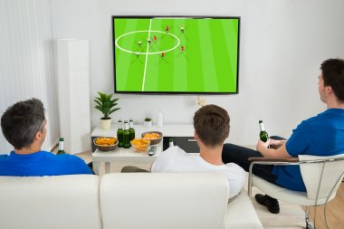 Men Watching Football Match