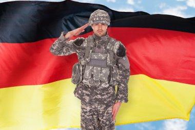 Portrait Of German Soldier Saluting In Front Of Flag stock vector