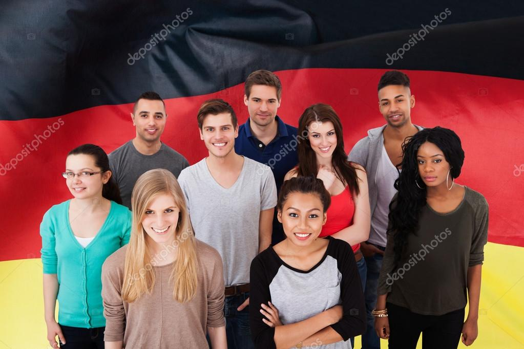 People In Front Of German Flag