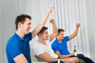 Men Holding Beer Bottles